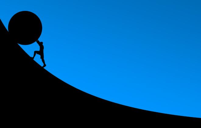Pushing a boulder uphill